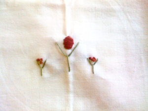 This one is pretty because it's simple, but I would have preferred to do posies all across the bottom of each side of the towel as opposed to the lower middle, like the others- just for a little variation.